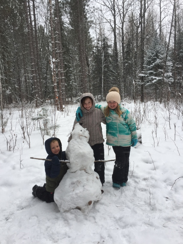 Kids Outdoors in Snow with Snowman